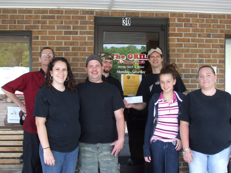 Jimmy Mac's present check to Friends of Panthertown