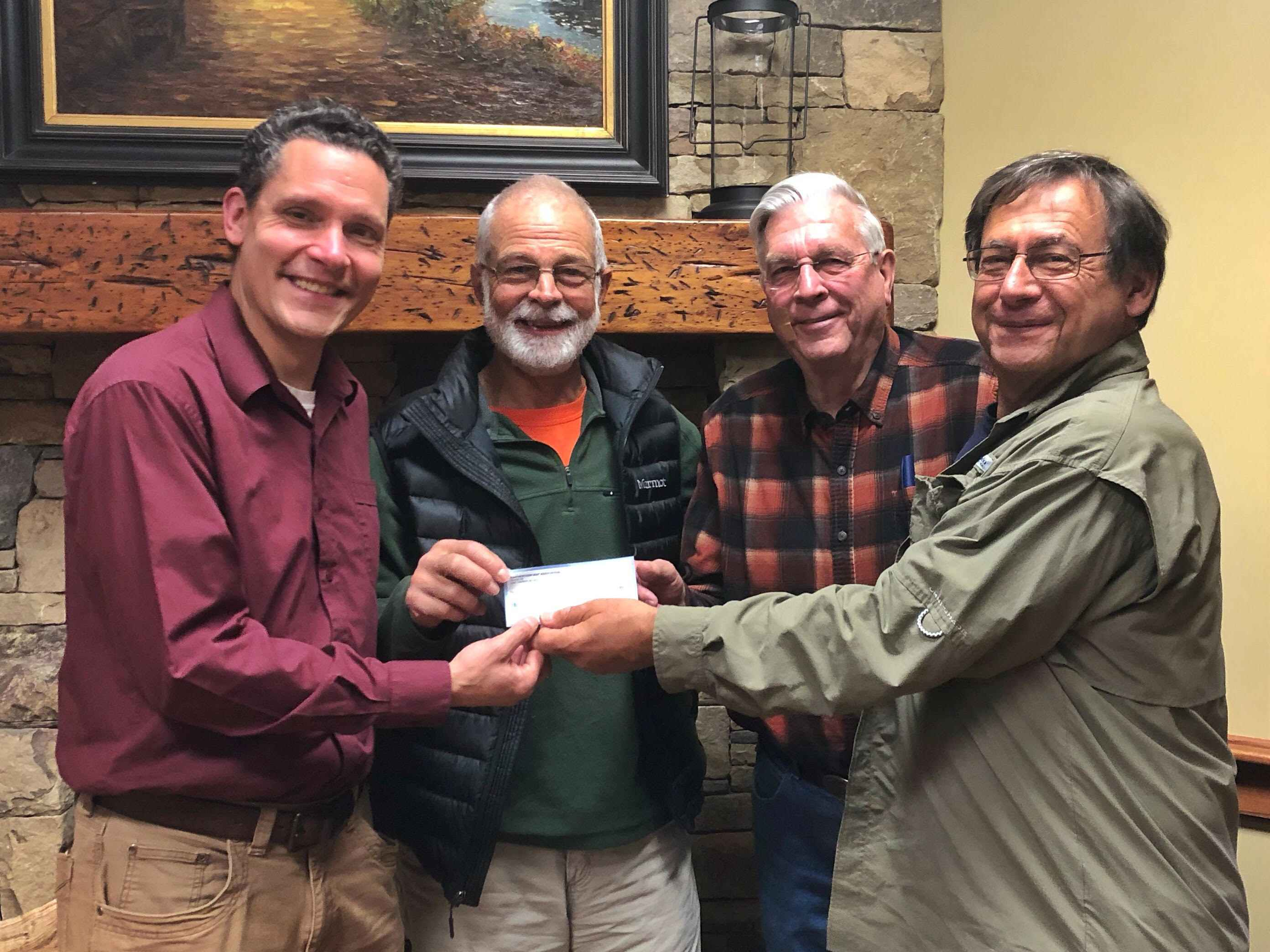 "Friends of Panthertown Executive Director, Jason  Kimenker, accepts a $7,500 donation from Panthertown Map  Association, non-profit publishers of Burt Kornegay's ""A Guide's Guide  to Panthertown"". You can order your copy online at panthertownmap.com"